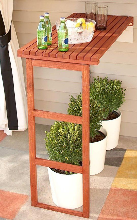 folding wooden console with space under it to place planters