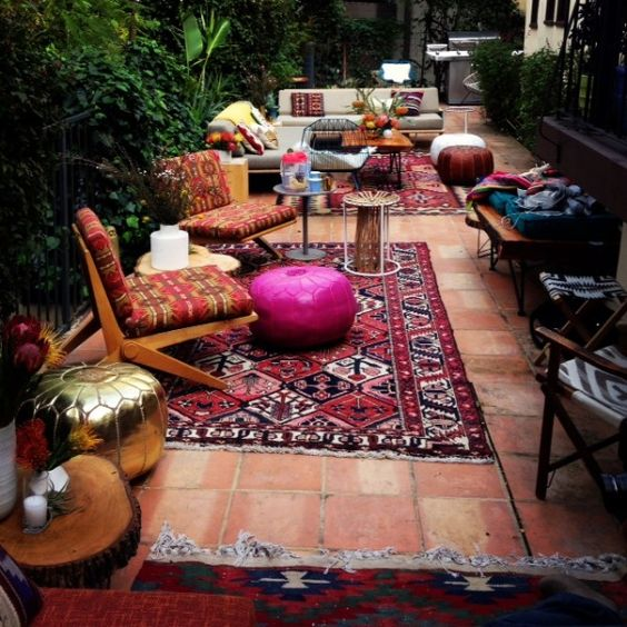 printed rugs and furniture with bold ottomans have a Moroccan flavor