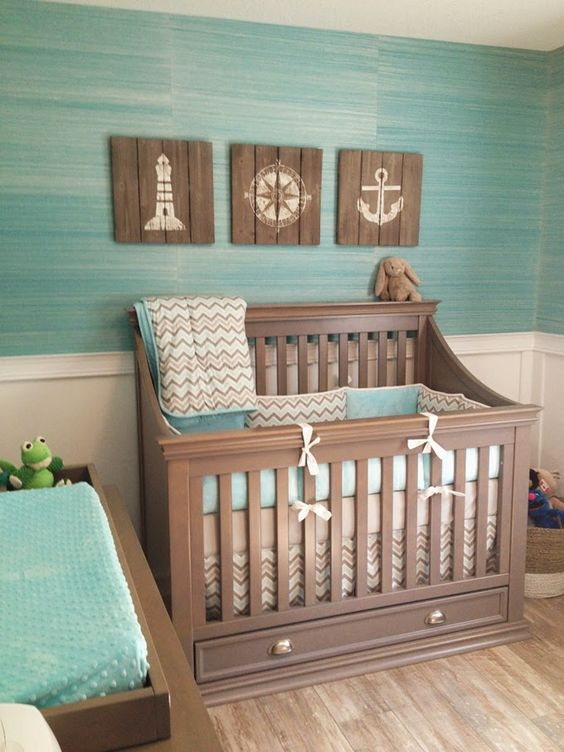 wooden signs with nautical prints for a seaside nursery