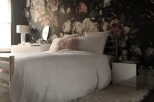 a moody floral wallpaper headboard wall is a chic accent in this feminine bedroom