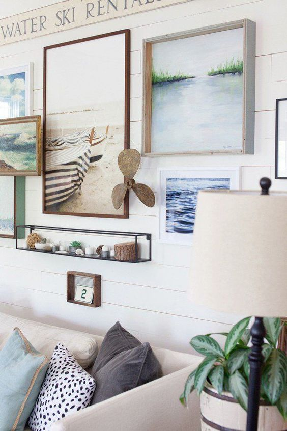 coastal-inspired wall with artworks and items connected with the sea