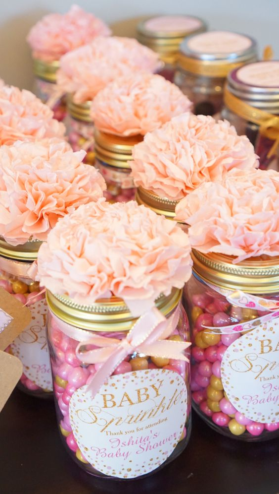 colorful candies in jars topped with fabric flowers