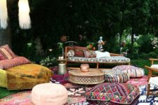 08 a boho lounge with printed rugs, ottomans and upholstery and tassels hanging