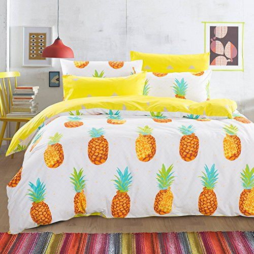 a pineapple and bold yellow bedding set for a sunny feel