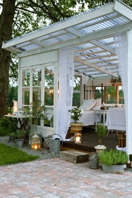 a small wood and glass house as an outdoor bedroom in your garden