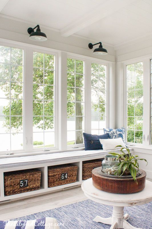 basket drawers in a sunroom for cozy and rustic storage