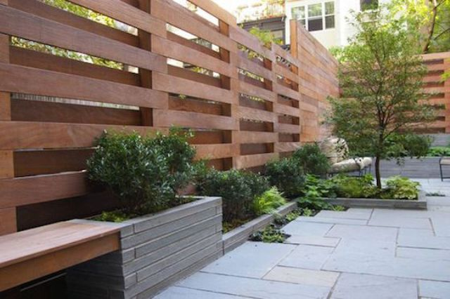 natural stain wooden screens with benches and planters attached to them