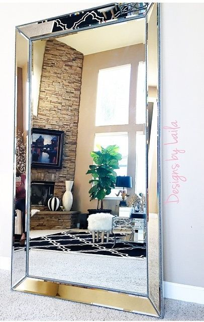 Overiszed Mirror In A Gold Frame Takes Lot Of Space And Makes Statement