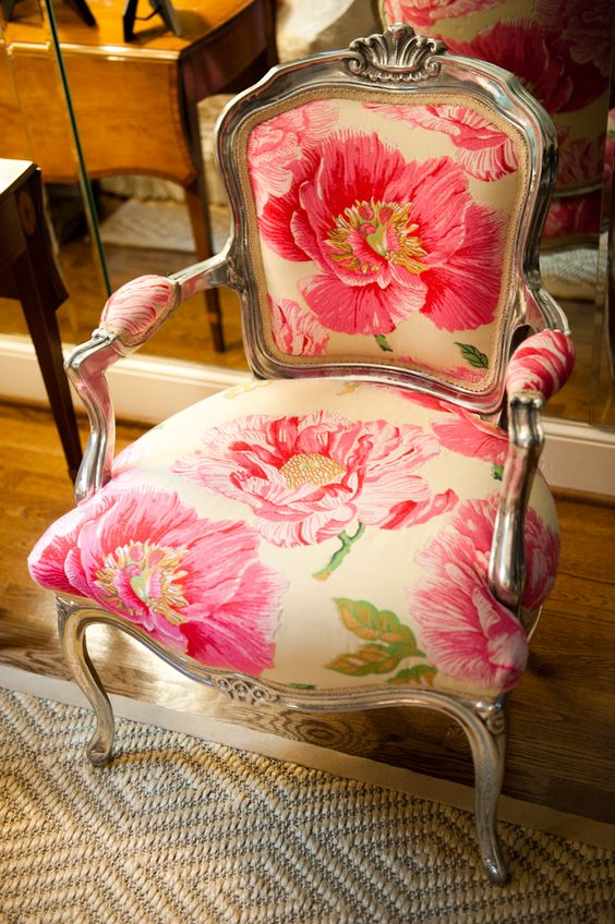 vintage chair with armrests and large scale pink flowers