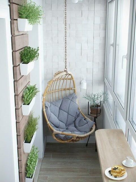 a folding table surface and a hanging chair with cushions