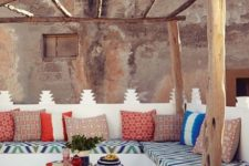 09 bold printed textiles on white and low tables look very Moroccan-inspired