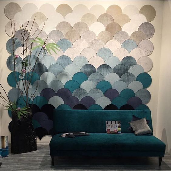 fabric fish scale art in different sea-inspired shades make a statement here