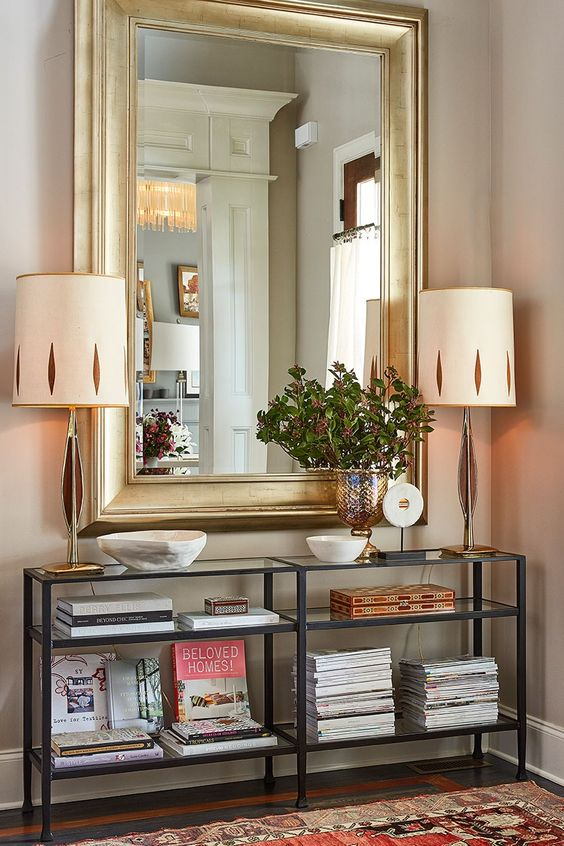 oversized rectangle mirror in a gilded frame makes a statement