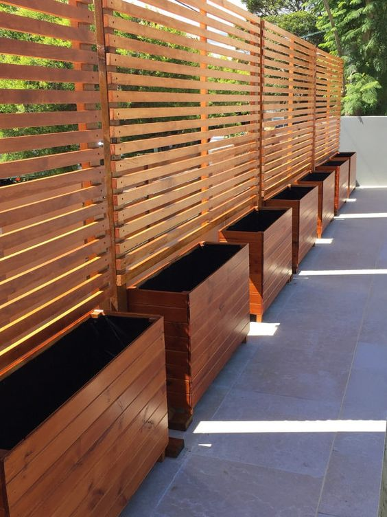 stained wood privacy screens with built-in planters