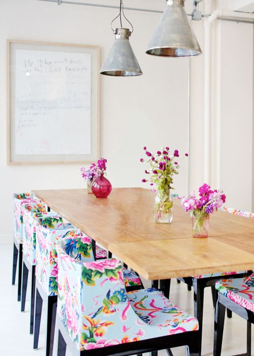 white stools on black legs and super colorful floral patterns