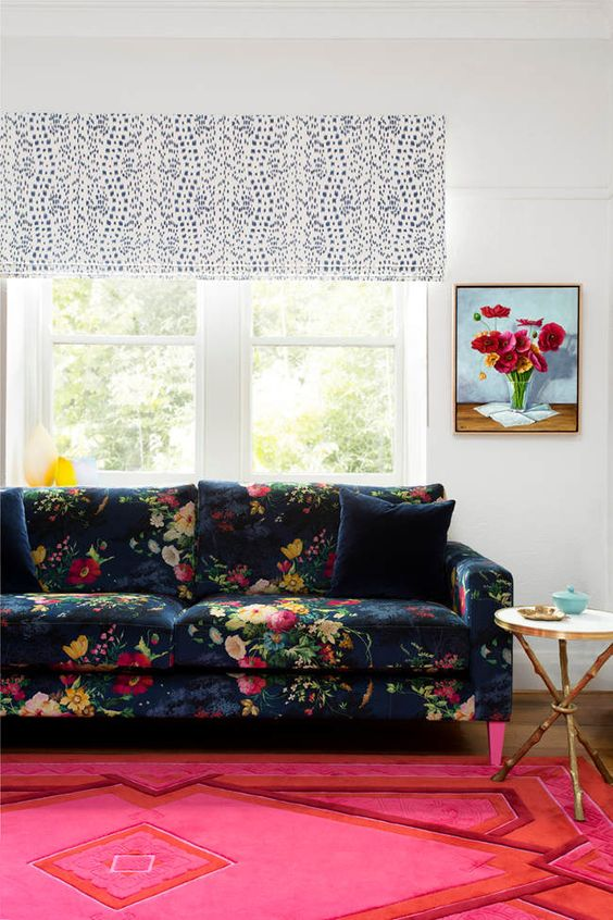a navy sofa with a super colorful floral print