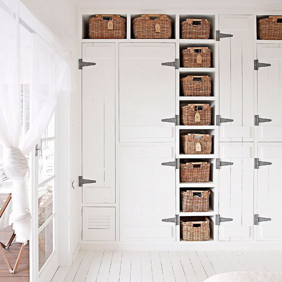 baskets with tags as drawers in a closet to make the clean white space softer