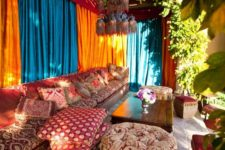 10 bold terrace with traditional metal lamps hanging and printed upholstery and textiles