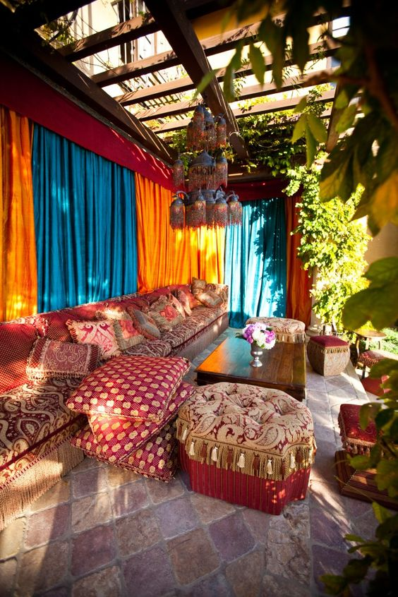 bold terrace with traditional metal lamps hanging and printed upholstery and textiles