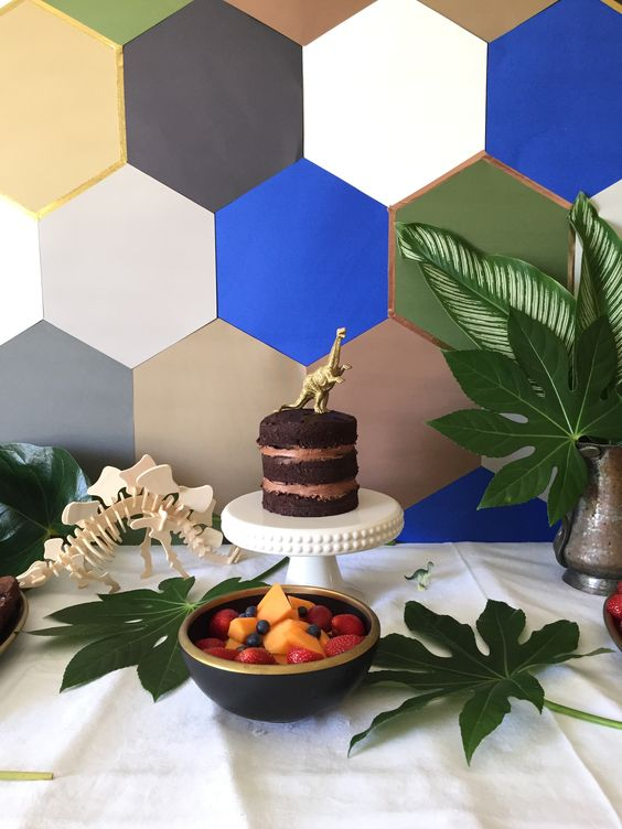 colorful hexagon dessert table backdrop is a great idea