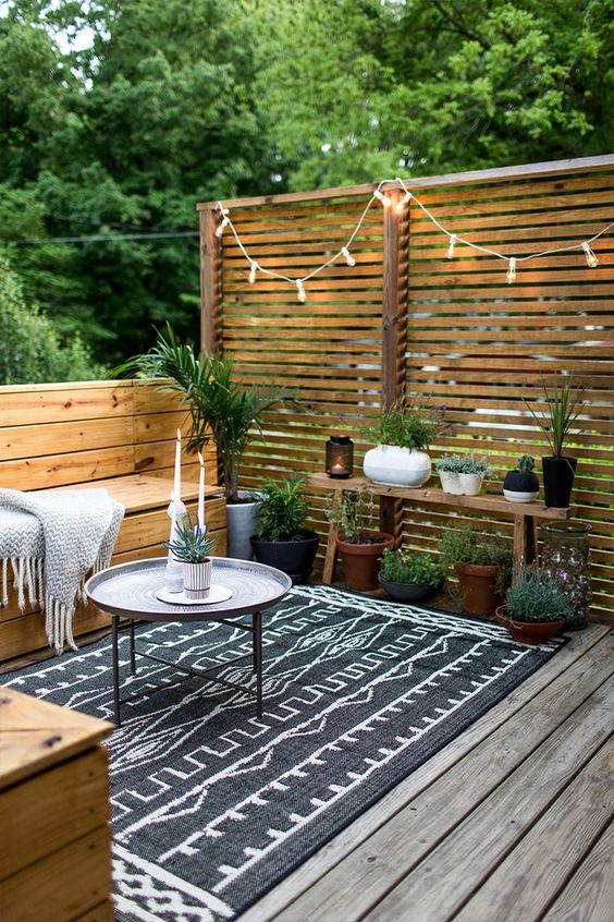 stained wooden screens and matching furniture for a natural deck look