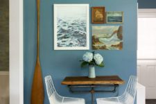 11 an oar attached to the wall in the dining area is a daring idea