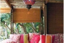 11 colorful print textiles and traditional lamps hanging create a real Moroccan ambience