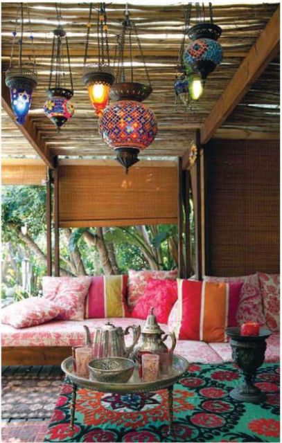 colorful print textiles and traditional lamps hanging create a real Moroccan ambience