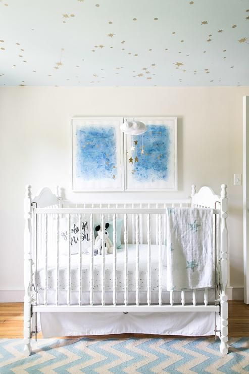 framed constellation duo art over the bed for a dreamy nursery