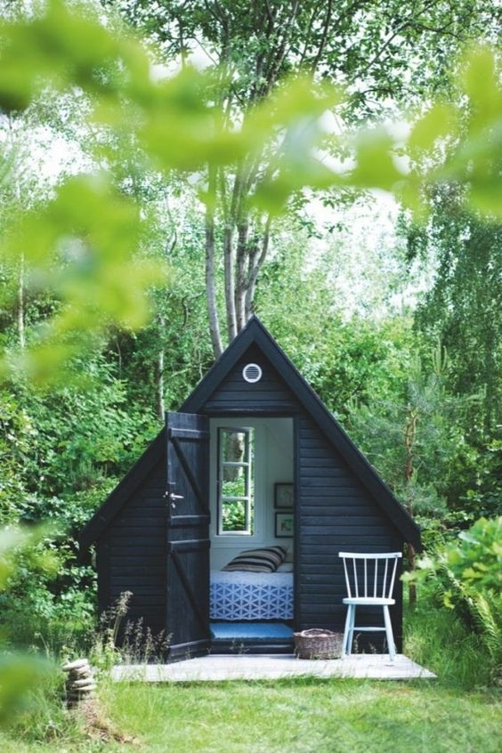 minimalistic triangular cottage-inspired she shed for a stylish look