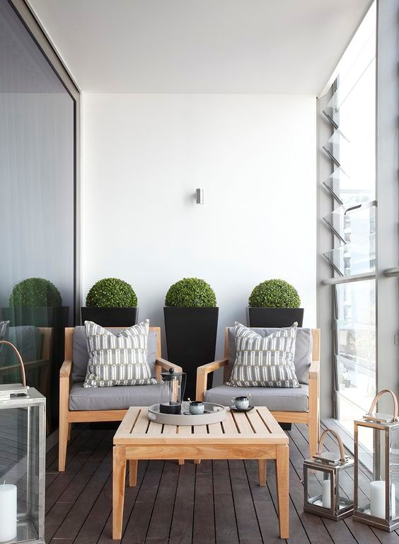simple wooden table and chairs are a perfect combo for any balcony and its base