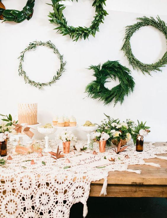 various greenery wreaths hanging over the table for cute decor
