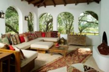 12 Moroccan lounge with bold printed pillows and traditional vases and rugs