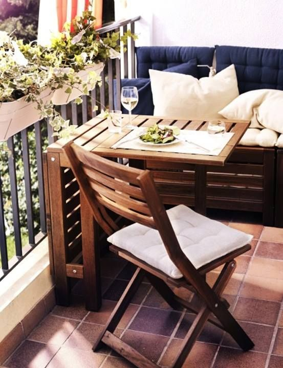 a small two seat cushioned bench, a folding table and a folding chair can be placed even on a small balcony