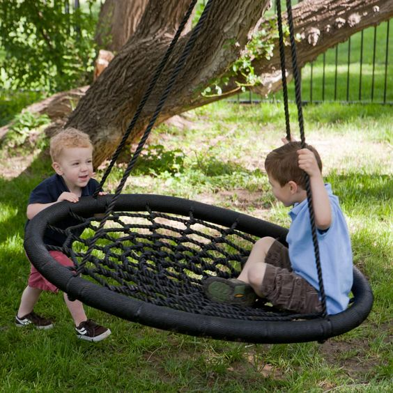 a spiderweb swing for several kids to play
