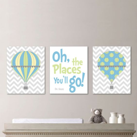 a trio of signs with hot air balloons and a quote