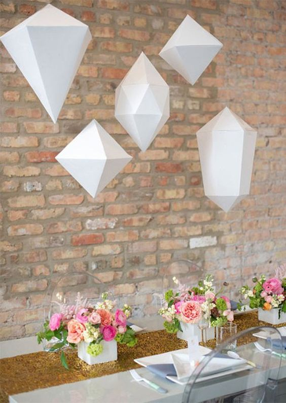 dimensional geometric pendants over the table for a modenr shower