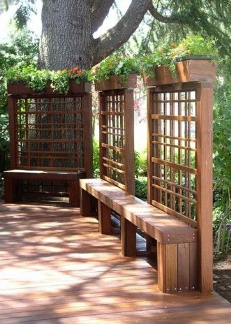 wooden screens with planters on top and benches attached for a cozy look