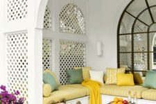 13 Moroccan terrace in white with bold cushions and pillows and traditional lanterns