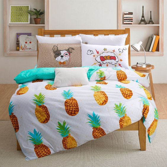 funky bed with a pineapple duvet for a tropical feel