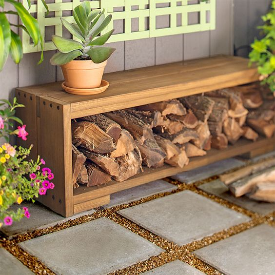 outdoor bench with an open storage space and firewood inside