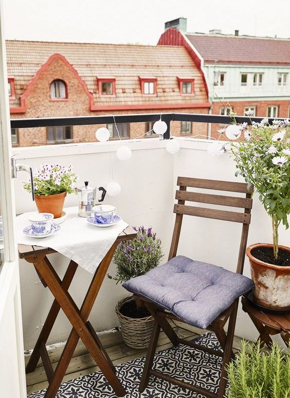 foldable chairs and a table for a tiny balcony make it possible