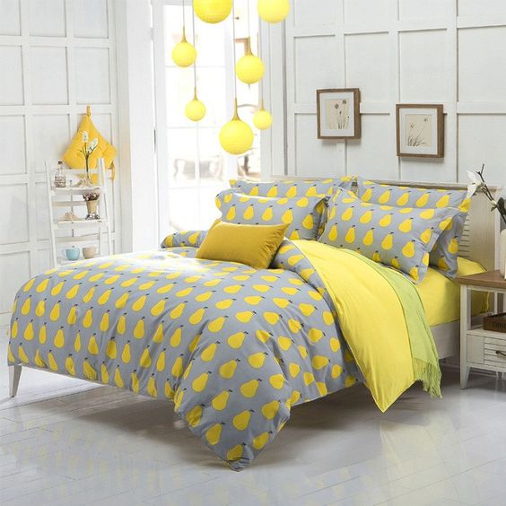 grey and yellow pear print bedding for a sunny feel