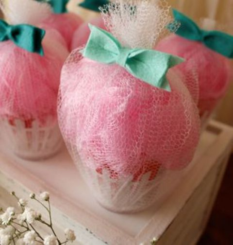 loofah and bath salt cupcake favors look super cute for a girl's baby shower
