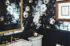 14 moody floral wallpaper makes this bathroom trendy because dark decor is a hot trend