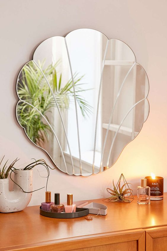 shell-shaped mirror is a cute and very modern idea for a bathroom