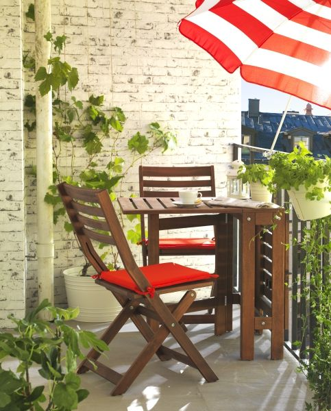 IKEA Gateleg table stained brown is ideal for a small balcony