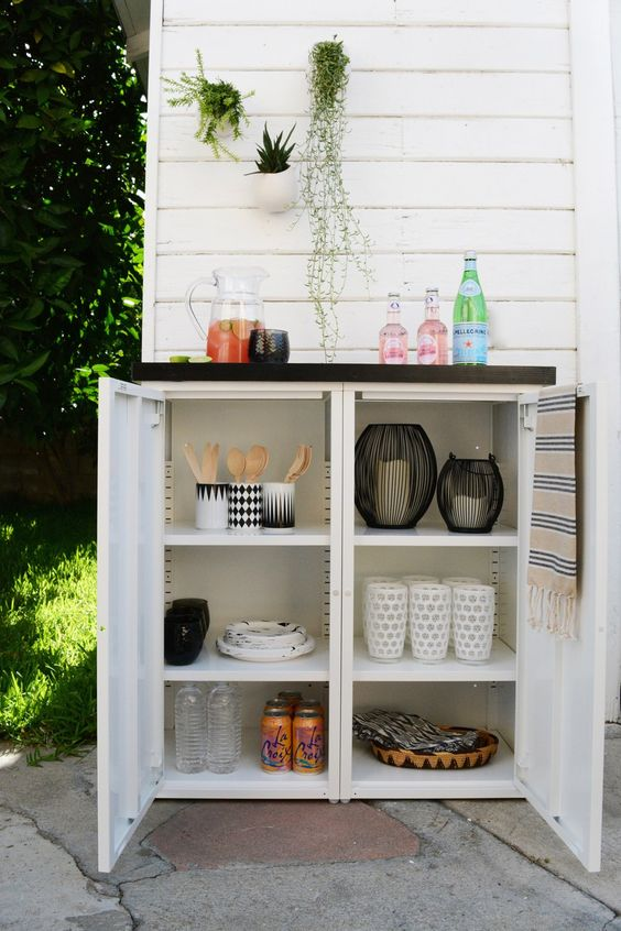 an outdoor buffet made of two Ikea metal cabinets and a custom tiled top