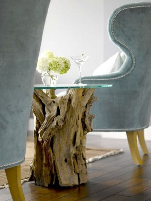 driftwood coffee table base and aqua-colored armchairs