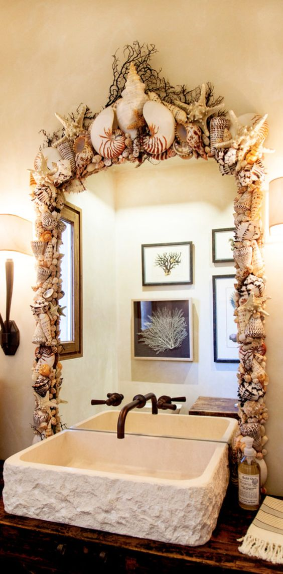 gorgeous lush shell and starfish covered bathroom mirror